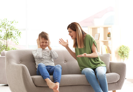 Mother arguing with son at home