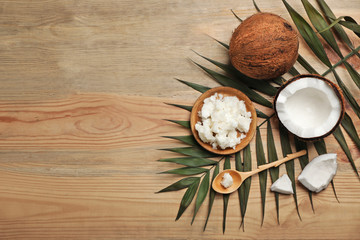 Flat lay composition with coconut oil on wooden background. Healthy cooking