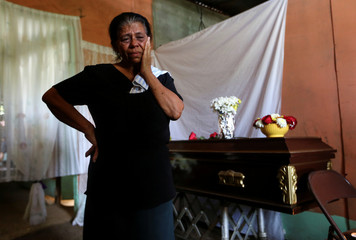 Ana Julia Herrera mother of Noel de Jesus Herrera, who was shot in recent protests against Nicaraguan President Daniel Ortega's government stands next to his coffin in Sebaco