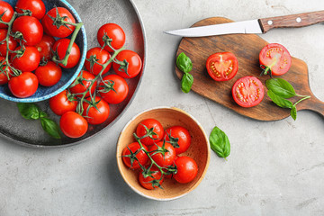 Flat lay composition with ripe tomatoes on table