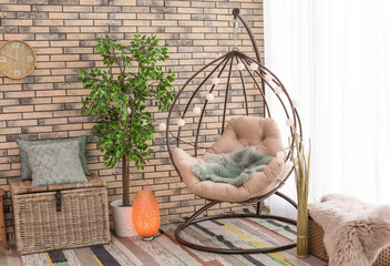 Comfortable hanging chair in modern living room interior
