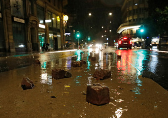 Cobblestones are pictured on Rue Centrale after a flash flooding during a heavy rain fall in Lausanne