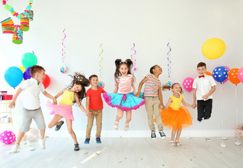 Cute little children at birthday party indoors