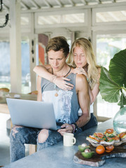 Young couple with laptop in morning