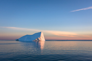 Iceberg in the sunset