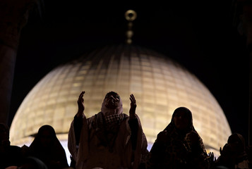Muslim women pray in front of the Dome of the Rock, on the compound known to Muslims as Noble Sanctuary and to Jews as Temple Mount, during Laylat al-Qadr in Jerusalem's Old City
