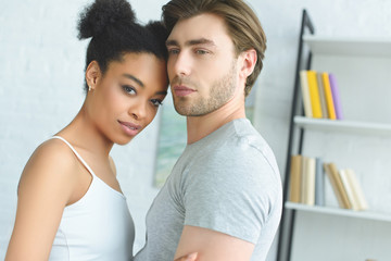 portrait of young multiethnic couple in love at home