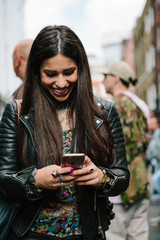 Young persian woman looking at a mobile phone