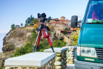 Camera on tripod and Meteora monasteries