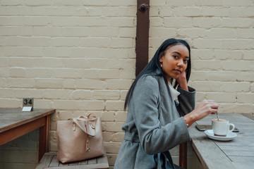 Woman Stirs Coffee