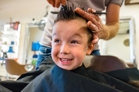 Cute Child Get a Haircut at the Barbershop