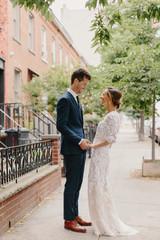 Bride and Groom Laughing on a Sidewalk in Brooklyn