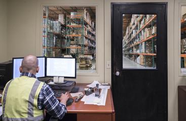 Warehouse worker in office