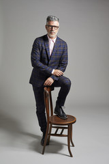 Portrait of an elegant man with a chair
