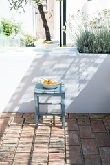 Blue bench with a portuguese porcelain font full of fruits in  typical mediterranean terrace