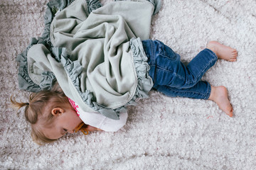 Toddler sleeping on a cozy blanket