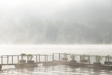 Chiangmai,Thailand-December 24,2017, A wooden bridge and fog in the lake at Mountain Float Chiang Mai , Mae Ngud Som Boon Chol dam, Chiangmai, Thailand.