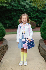 Adorable young girl ready for her first day of kindergarter