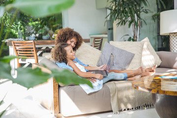 Mother and daughter watching videos on laptop