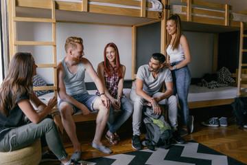 Young People Talking in Hostel Bedroom