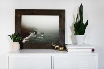 Large framed photo on white cabinet