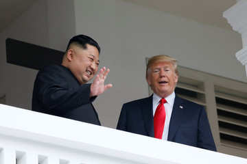 U.S. President Donald Trump talks with North Korean leader Kim Jong Un at the Capella Hotel on Sentosa island in Singapore