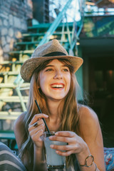 Portrait Of Beautiful Smiling Girl Wearing A Hat