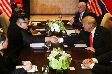 U.S. President Donald Trump shakes hands with North Korea's leader Kim Jong Un before their meeting in Singapore