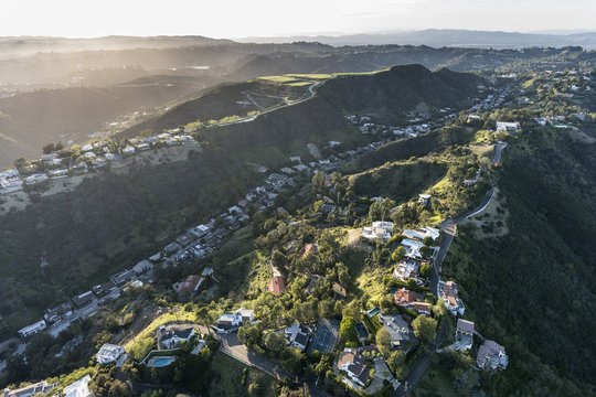 Aerial view of South Beverly Park hilltop homes in the Santa Monica Mountains above Beverly Hills and Los Angeles, California.