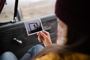 Woman in car watching photo