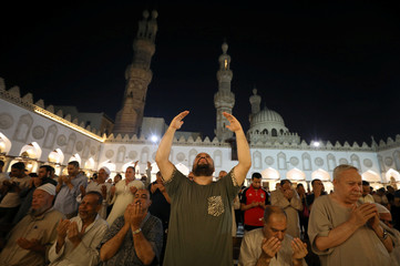 """Muslims take part in evening prayers called """"Tarawih"""" on Laylat al-Qadr or Night of Decree, during the holy fasting month of Ramadan, at Al Azhar mosque in Cairo"""