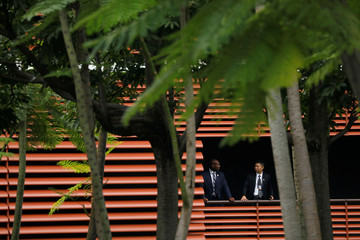 Security personnel are seen during a meeting between U.S. President Donald Trump and North Korea's leader Kim Jong Un at the Capella Hotel on the resort island of Sentosa, Singapore