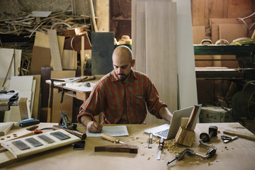 Young entrepreneur working in his workshop