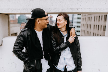 Mixed Race couple on roof top