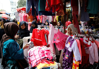 People shop at Tanah Abang traditional market ahead of the upcoming Eid al-Fitr holiday marking the end of the Muslim holy month of Ramadan in Jakarta