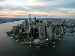 Lower Manhattan and the New York Harbor at sunset from above.