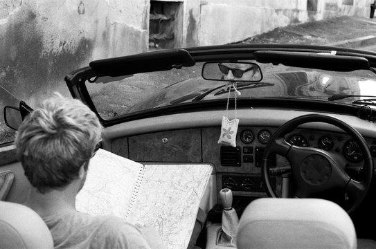 Man in classic car