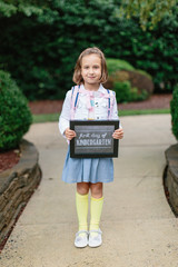 Cute young girl ready for her first day of kindergarten