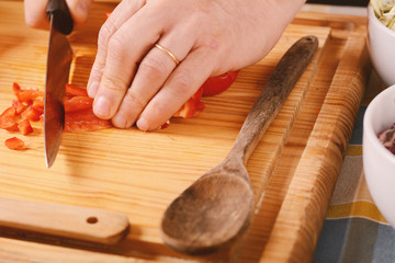 Close up of man cutting vegetables on the board
