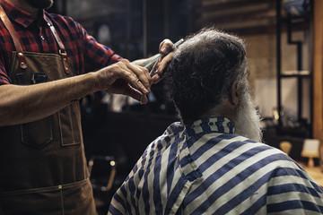Hairdresser Cutting Man's Hair