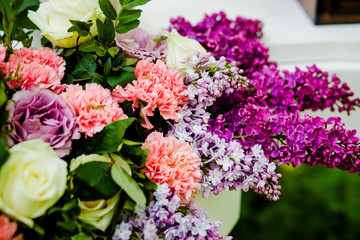 Sweet bouquet lilac flowers standing on the table