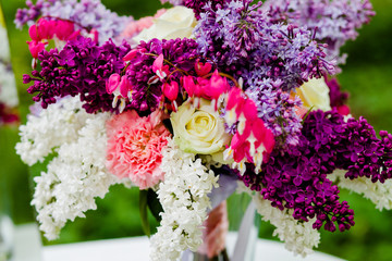 Bouquet lilac flowers standing on the table