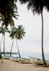 Boats on tropical coastline
