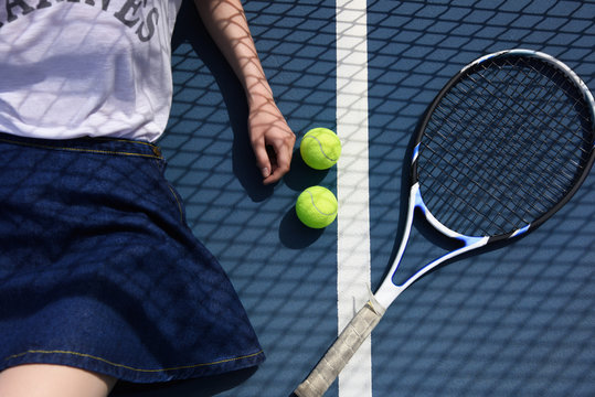 Tennis player lying on court