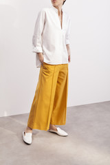 fashionable woman wearing culottes