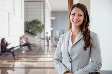 Bright vibrant portrait of beautiful woman business executive style in downtown financial bank building