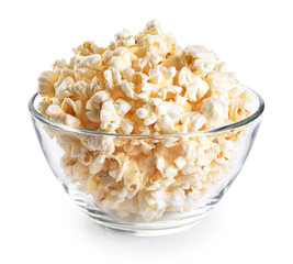 Stores photo Graine, aromate Popcorn in a glass bowl isolated on a white background.