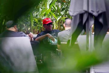 Former U.S. basketball star Dennis Rodman talks at the poolside of Regent Hotel in Singapore