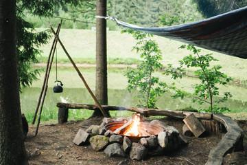 A teapot on a bonfire.