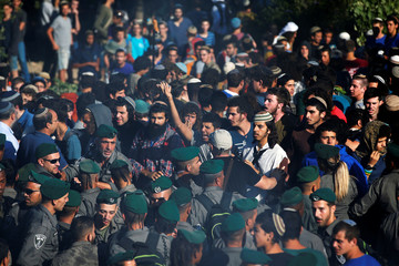 Israeli security forces scuffle with protestors as they come to evacuate 15 Jewish settler families from the illegal outpost of Netiv Ha'avot in the Israeli occupied West Bank